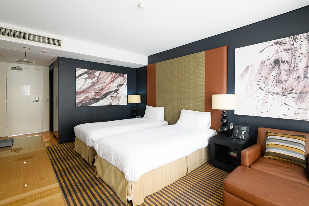 Interior view of the MGSM north ryde executive hotel, picturing the living room and balcony viewing out onto the grounds