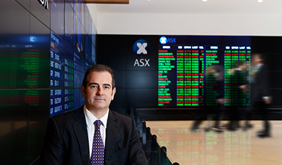 Man standing next to stock market