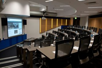 A small conference room shaped like a lecture theatre