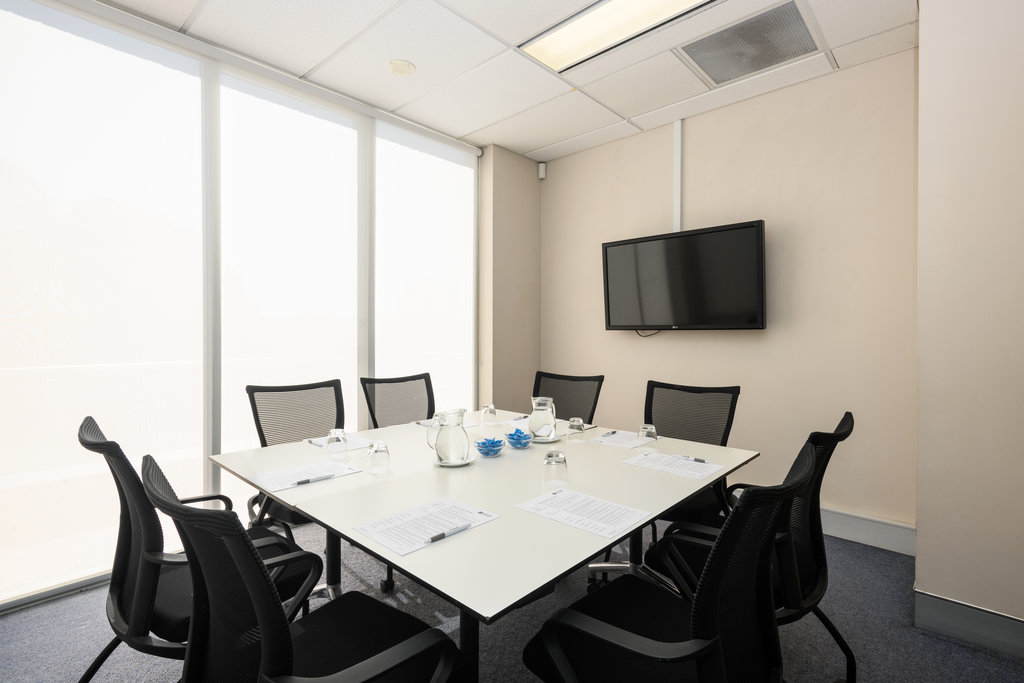A small conference room similar to a boardroom
